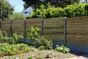 Palissade en bois et béton sur mesure par Greenrod - votre partenaire multi-services